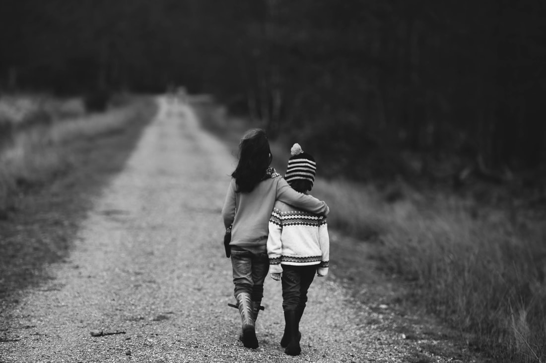 Children Walking a Path and embracing - Forgiveness and Friendship