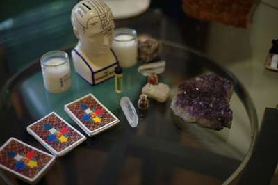 Palm and Tarot Card Reading table with spiritual crystals