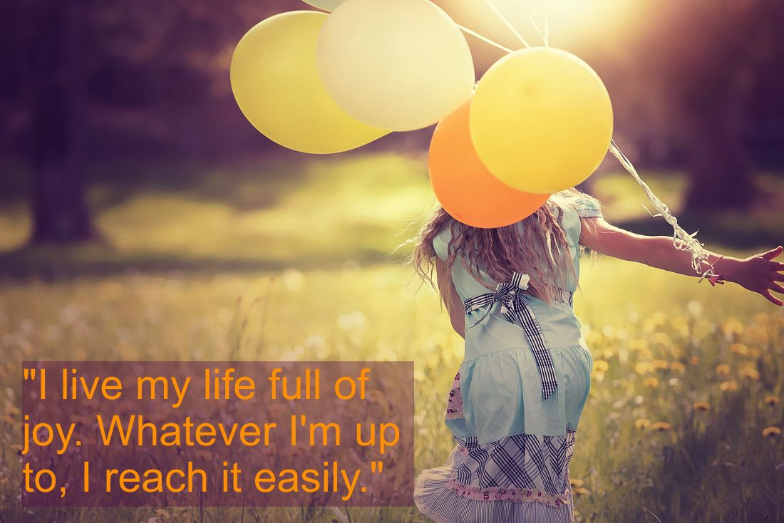 Happy andjoyful girl in a flower meadow with balloons and Spiritual Affirmation: