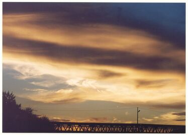 Sunset over Bridge - The angels ask you to finally remove the ballast that you are carrying with you