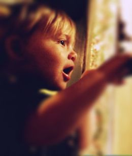 child sees miracles of life outside of the window